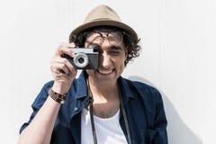 Joyful trendy teenager making photo with smile Royalty Free Stock Image