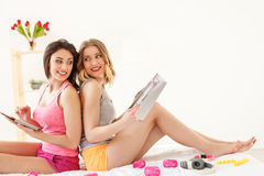 Joyful two women making pajama party Stock Image