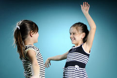 Joyful white twins dancing Stock Photo