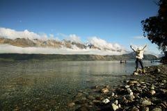 Joyful Woman. Victorious woman standing at New Zealand Lake Royalty Free Stock Photo
