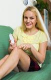 Joyful woman applying gel Royalty Free Stock Image