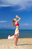 Joyful woman with arms raised at the beach Royalty Free Stock Photo