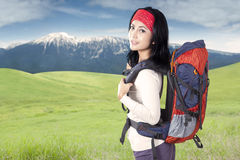 Joyful woman with backpack walk at mountain Stock Images