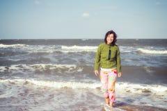 Joyful woman on the beach Royalty Free Stock Photos