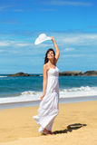 Joyful woman on beach vacation royalty free stock photo
