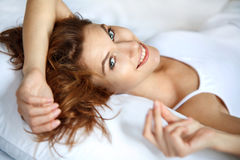 Joyful woman in bed Stock Photography