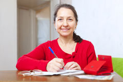 Joyful  woman with bill and money Royalty Free Stock Image