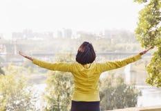 Joyful woman breathing fresh air outdoors stock photos