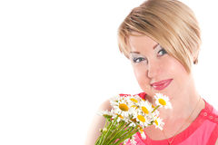 The joyful woman with camomiles Stock Photos
