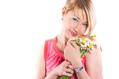 The joyful woman with camomiles Royalty Free Stock Images
