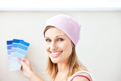 Joyful woman choosing color for painting a room Stock Photos