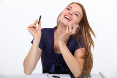Joyful woman at a desk. Joyful woman sat at a desk Royalty Free Stock Photo