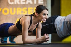 Joyful woman is doing plank inside Royalty Free Stock Photo