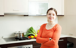 Joyful woman in domestic kitchen Royalty Free Stock Photo