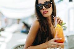 Joyful woman drinking cocktail Royalty Free Stock Photos