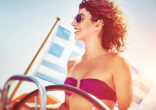 Joyful woman driving sailboat Stock Image