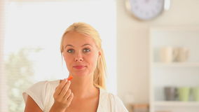 Joyful woman eating vegetable slices Stock Image