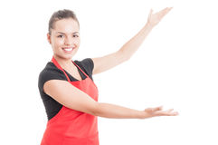 Joyful woman employee presenting sales on hypermarket Royalty Free Stock Photography