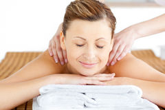 Joyful woman enjoying a back massage Royalty Free Stock Photos
