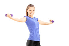 Joyful woman exercising with dumbbells Stock Image