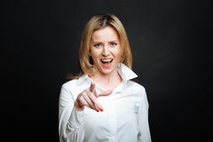 Joyful woman expressing happiness in the black colored studio. Your turn to improve the life . Attractive amused positive woman smiling and expressing positivity royalty free stock image