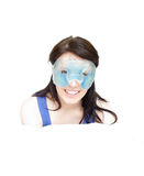 Joyful woman with an eye gel mask Royalty Free Stock Photos