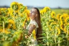 Joyful woman in the field. Royalty Free Stock Image