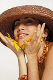 Joyful woman with flower petals Royalty Free Stock Image