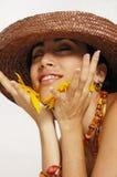 Joyful woman with flower petals royalty free stock image