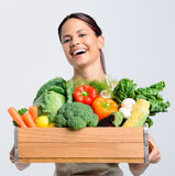 Joyful woman with fresh produce Stock Photos