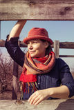 Joyful woman in funny hat. Standing in park in sunny day and looking into the distance. Toned image Royalty Free Stock Photo