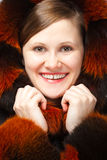 Joyful woman in fur Stock Images