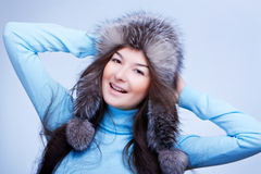 Joyful woman in fur cap Royalty Free Stock Images