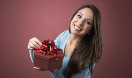 Joyful woman with gift box Stock Image