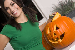 Joyful Woman Carved Pumpkin at Halloween Holiday Royalty Free Stock Images