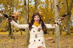 Joyful woman having fun in autumn city park Royalty Free Stock Image