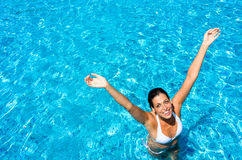 Joyful woman having fun in swimming pool Stock Image