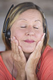 Joyful woman with headphones music listening Stock Photography