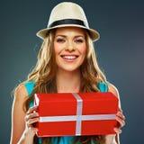 Joyful woman hold present. big toothy smile. Blue dress Royalty Free Stock Photography