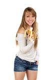 Joyful woman holding banana. In her hand and smiling. Isolated on white Royalty Free Stock Photos