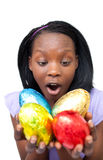 Joyful woman holding colorful Easter eggs Stock Photography