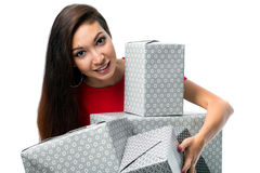 Joyful woman holding a lot of gray boxes on a white background Royalty Free Stock Photography