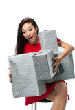 Joyful woman holding a lot of gray boxes on a white background Royalty Free Stock Images