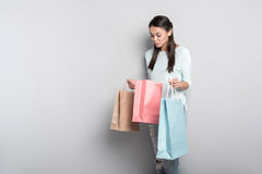Joyful woman holding packages Royalty Free Stock Photos
