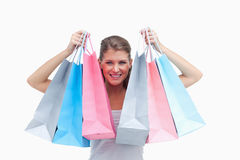 Joyful woman holding shopping bags Royalty Free Stock Photos