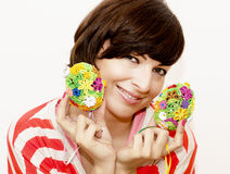 Joyful woman holding two colorful easter eggs Stock Photo