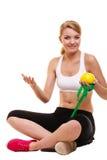 Joyful woman holds grapefruit and measurement tape Stock Image