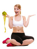 Joyful woman holds grapefruit and measurement tape Stock Images