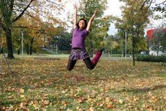 Joyful woman jumping Royalty Free Stock Image