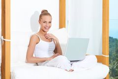 Joyful woman laughing with laptop Royalty Free Stock Photo